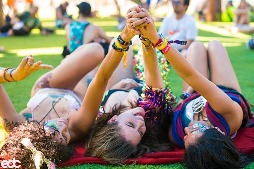 Camp Electric Daisy Carnival Girls Laying In The Grass